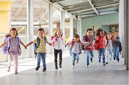 kids running through the school halls