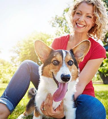 woman and corgi dog best community