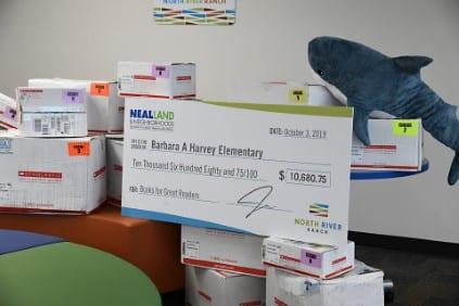 Barbara A Harvey Elementary Book Donation Neal Land