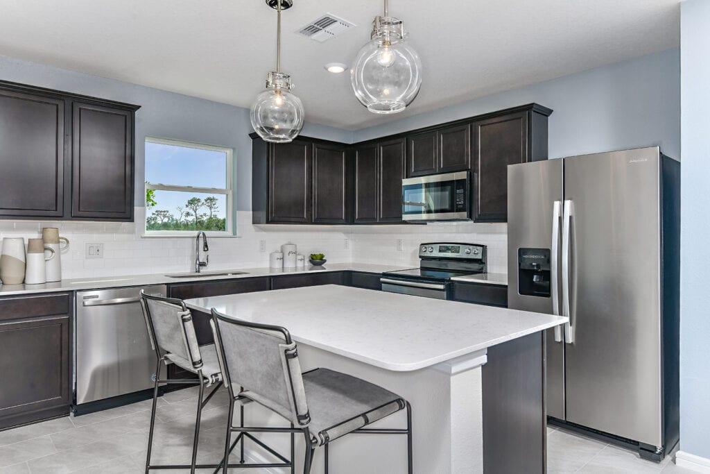 Centex model home north river ranch espresso kitchen