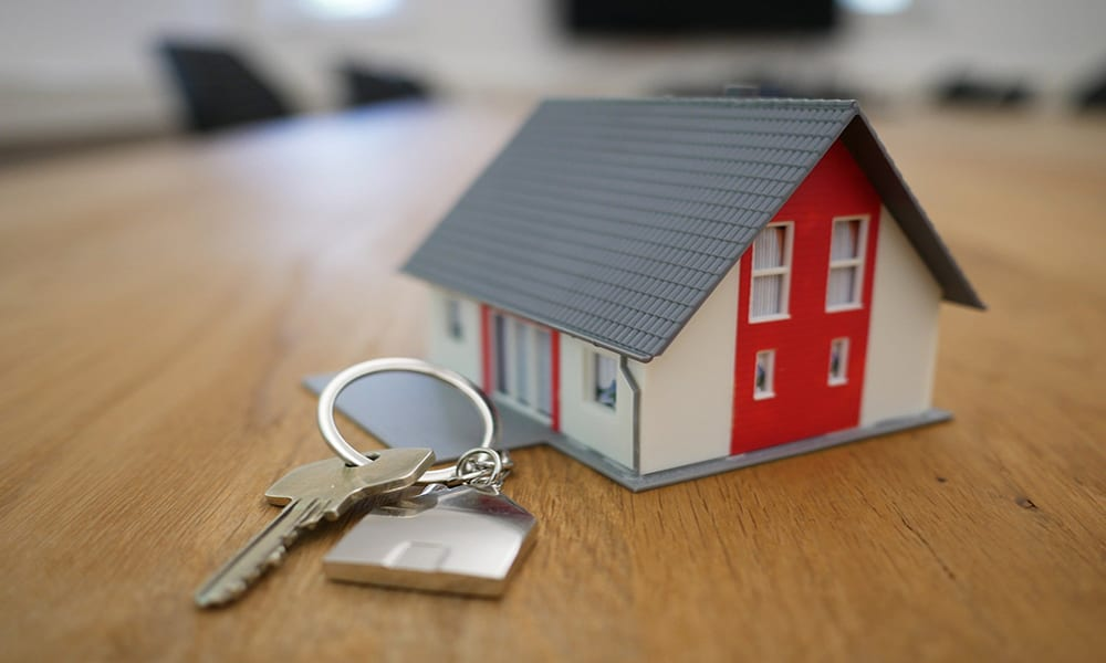 Real estate investors build a house with keys
