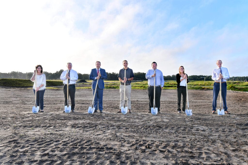 Neal Land Team with shovels at Groundbreaking