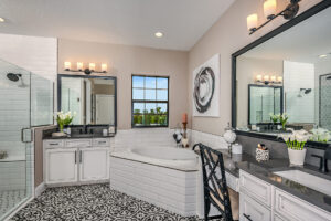 black and white master bathroom with garden tub