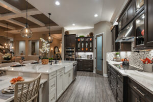 Gourmet kitchen in spice and white model home north river ranch