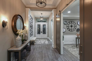 Entrance foyer with tile floor and tray ceiling