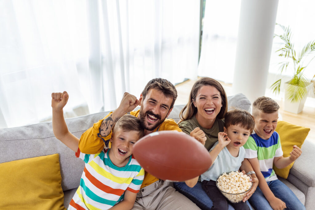 family at football party with snacks