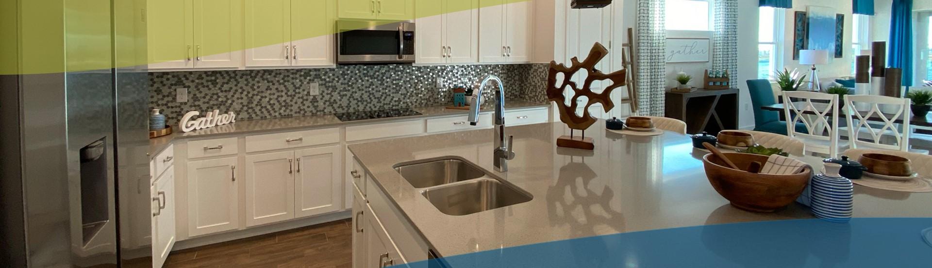 white kitchen with mosaic backsplash at north river ranch