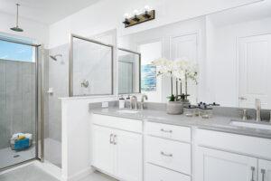White and grey quartz master bathroom