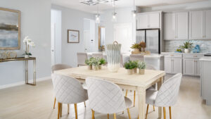 white and gold kitchen and dining model home