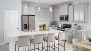 White kitchen gold accents model home