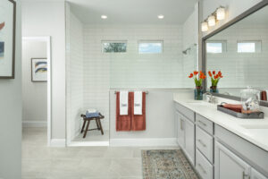 white and grey bathroom walk in shower dual sinks