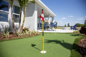 Putting green rear yard model home north river ranch