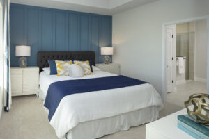 White bed linens with blue accent wall north river ranch