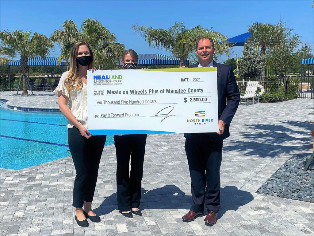 Charity check presentation at North River ranch pool