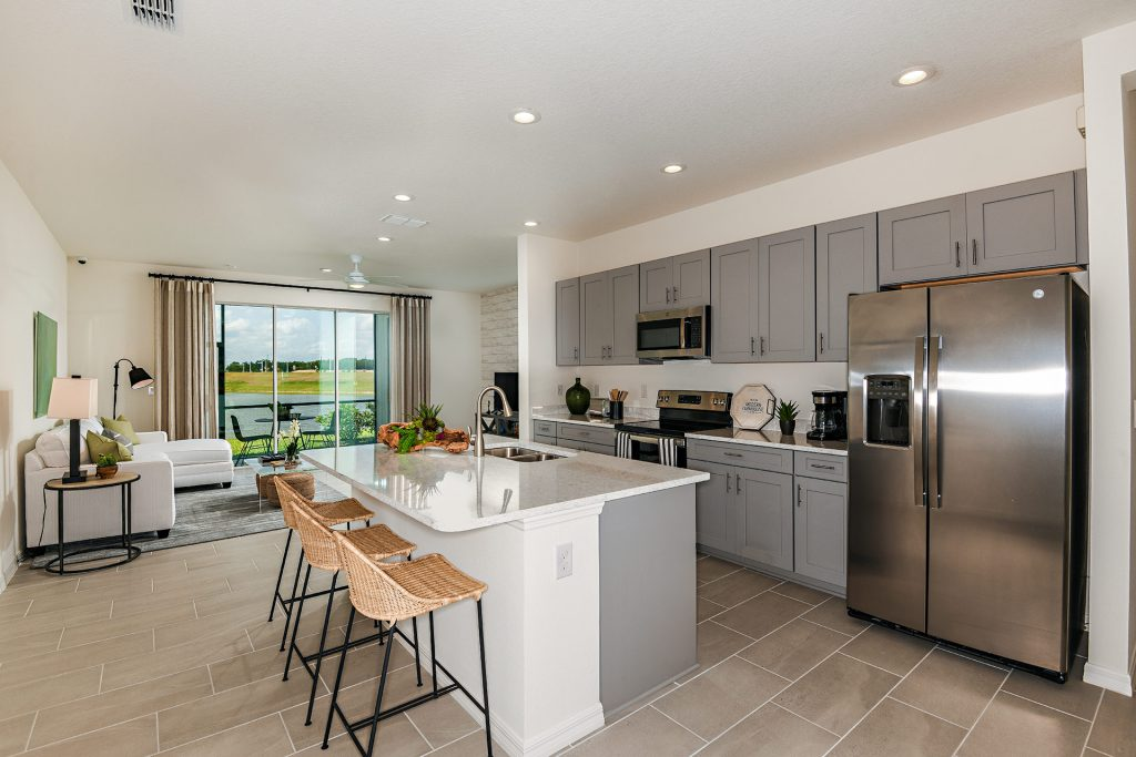 Grey cabinets white counters stainless steel kitchen north river ranch