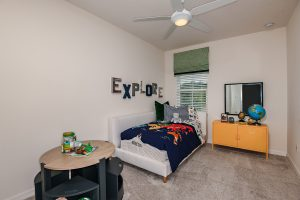 Kids room with daybed, globe, toys north river ranch