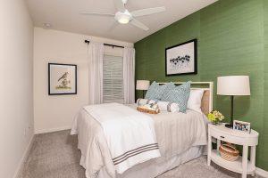 Guest bedroom cream linens grey wallpaper white furnishings