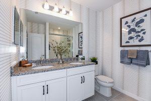 Dual vanity sinks white master bathroom