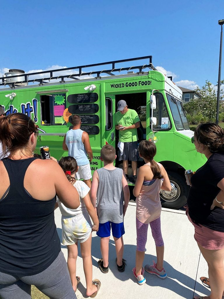 People ordering food from food truck north river ranch