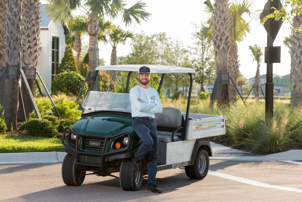Young man with service golf cart north river ranch